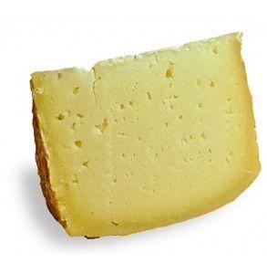 Trancio di formaggio Canestrato di Moliterno IGP